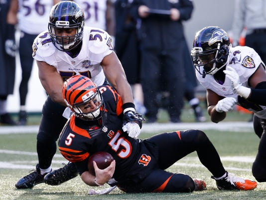 Cincinnati Bengals quarterback AJ McCarron (5) is sacked by Baltimore Ravens inside linebacker Daryl Smith (51) as linebacker Zach Orr (54) closes in in the second half of an NFL football game, Sunday, Jan. 3, 2016, in Cincinnati. (AP Photo/Frank Victores)