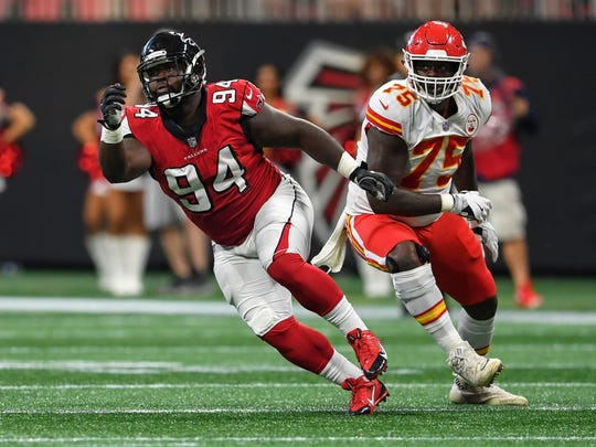 Atlanta Falcons defensive tackle Deadrin Senat (94) fights off a block by Kansas City Chiefs offensive tackle Cameron Erving (75) during the first quarter at Mercedes-Benz Stadium. Senat is one of four Immokalee NFL players conducting a youth camp on July 13.