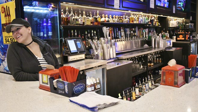 5th Quarter's bartender Kristen Chambers talks to customers Wednesday afternoon.
