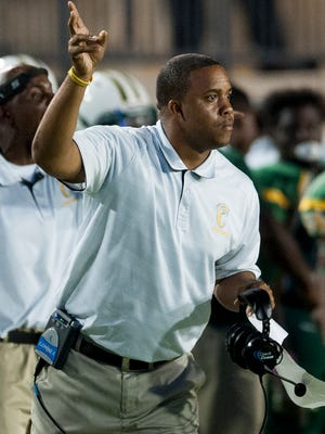 Carver coach Billy Gresham, shown in a game last year, and wife Nakia are about to welcome their third child.