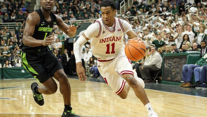 Jan 19, 2018; East Lansing, MI, USA; Indiana Hoosiers guard Devonte Green (11) dribbles the ball around Michigan State Spartans guard Joshua Langford (1) during the first half of a game at Jack Breslin Student Events Center. Mandatory Credit: Mike Carter-USA TODAY Sports