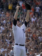 Joe Nathan exults after getting the last out in a 3-0 win over the Minnesota Twins on Sept. 28, 2014 - a victory that clinched the American League Central Division for the Tigers.