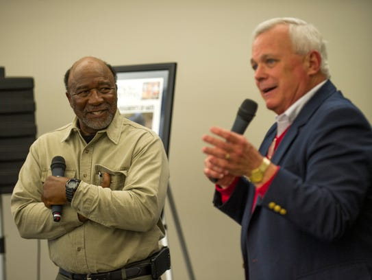 Charles Moulden, left, listens to remarks by News Sentinel columnist Sam Venable during a reception in his honor on Monday, March 24, 2014, at the News Sentinel. Moulden meet with readers after the News Sentinel recently published a series of articles about his racially-motivated shooting nearly 46 years ago in Monroe County.