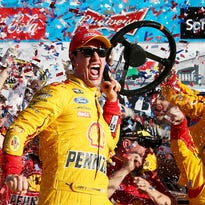 Joey Logano celebrates in victory lane after winning the 57th Annual Daytona 500 on Sunday at Daytona International Speedway. It was his first Daytona 500 victory.