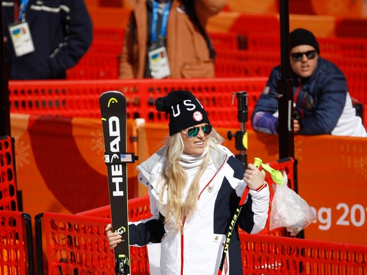 Lindsey Vonn, of the United States, departs after skiing at a ladies' downhill training session during the 2018 Winter Olympics in Jeongseon, South Korea, Sunday, Feb. 18, 2018. (AP Photo/Patrick Semansky)