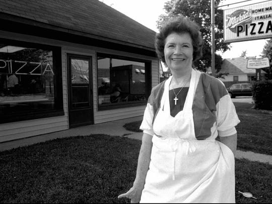 Mary Warble outside her pizza parlor on Shelby Street in 1994.