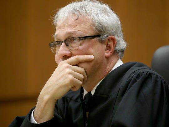 Judge Alex Renzi is challenging a parole board decision to release convicted rapist Michael Eades.