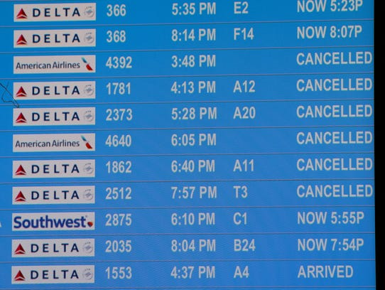 Information monitors list Miami with cancelled flights