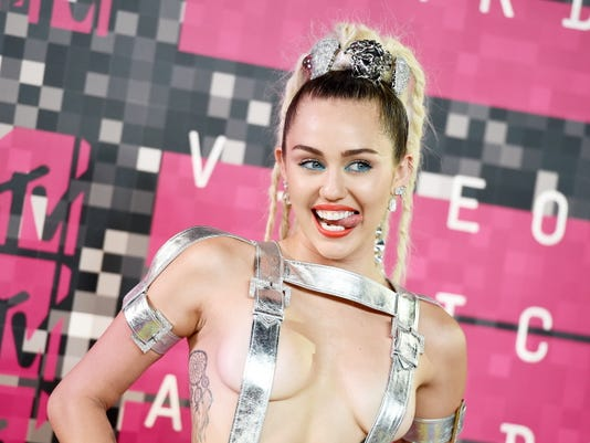 Jourdan Strauss — Invision Miley Cyrus arrives at the MTV Video Music Awards at the Microsoft Theater on Sunday, Aug. 30, 2015, in Los Angeles.
