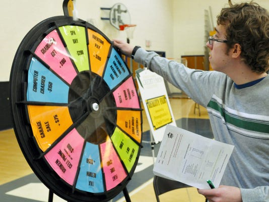 George Bunker, a senior at Chambersburg Area Senior High School, spins the Wheel of Reality during the school's first-ever Reality Fair on Tuesday.