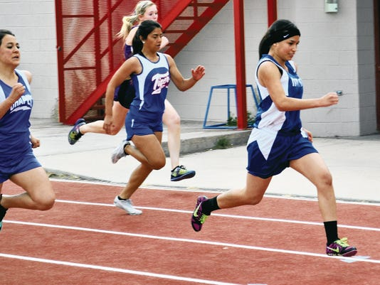 Hondo's Blanca Villanueva finishes the 100 meter dash.