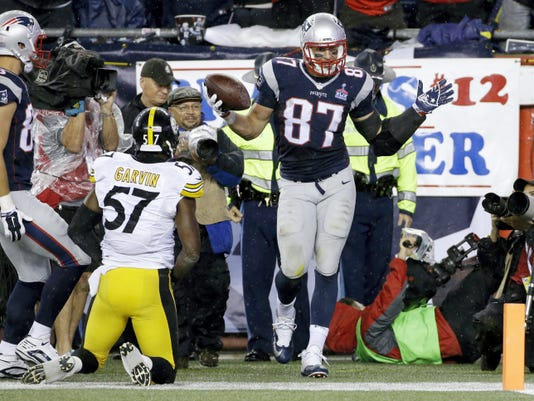 New England Patriots tight end Rob Gronkowski, right, celebrates his touchdown against the Pittsburgh Steelers in the second half on Thursday in Foxborough, Mass.