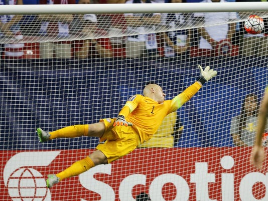 The ball gets past United States goalkeeper Brad Guzan for a Jamaica goal during the first half of Wednesday's CONCACAF Gold Cup soccer semifinal in Atlanta.