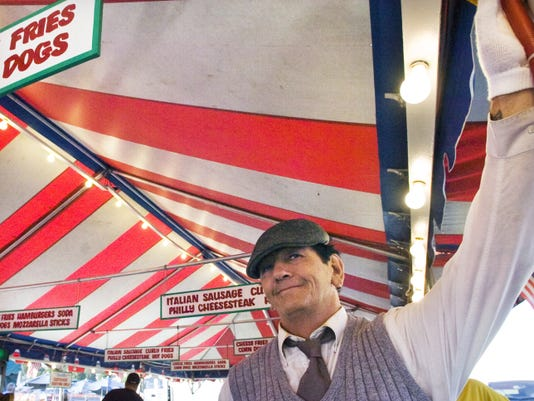 """Damond Bear, of Syracuse, N.Y., who's performed the """"mechanical man"""" act at the York Fair for 50 years on-and-off, during a break in 2014. The routine has taken him everywhere from the Erie County Fair in Hamburg, N.Y., to Venezuela."""