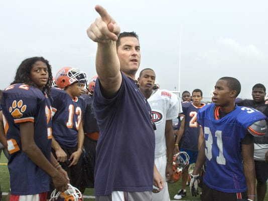 William Penn Football coach Shawn Heinold directs his team to their position drills during a 2010 practice. William Penn will open the head football coaching position to applicants after a winless season.