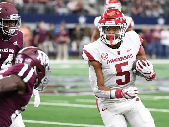 Arkansas running back Rakeem Boyd (5) turns upfield against Texas A&M during the second quarter of an NCAA college football game, Saturday, Sept. 29, 2018, in Arlington, Texas. (AP Photo/Jeffrey McWhorter)