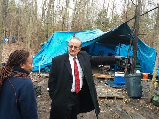 County Executive Tom Gordon and executive assistant Angela Walker tour the tent area adjacent to University Plaza in Christiana. The encampment bordered Del. 273 and Old Baltimore Pike.