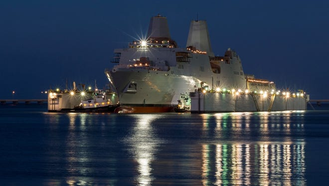 The amphibious transport dock ship Pre-Commissioning Unit (PCU) John P. Murtha (LPD 26) is launched from the Huntington Ingalls Industries shipyard in Pascagoula, Miss.