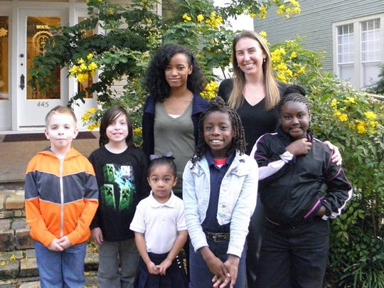 Program Manager Hillary Frazier (on left) and new Executive Director, Sarah Touchstone with students at the Renzi Education and Art Center.