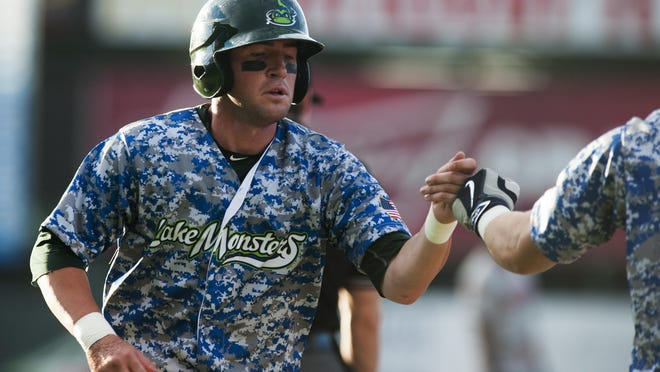 Lake Monsters runner Skye Bolt (7) is congratulated as he crosses home plate for a run during a game against the Auburn Doubledays earlier this season.