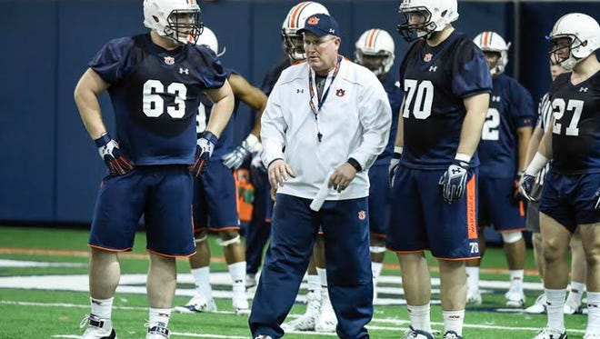 Auburn offensive line coach Herb Hand working with the Tigers starting unit during spring practice. Hand and Malzahn combined at Tulsa to create one of the nation's best offenses in 2007 and 2008.
