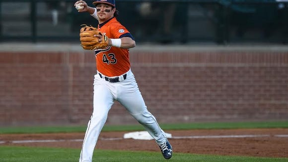 Auburn infielder Kyler Deese (43) fielding a ground