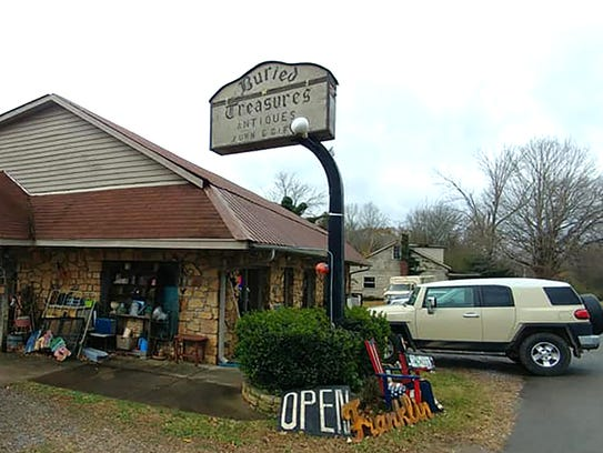 Buried Treasures Antiques, Furniture & Gifts is located