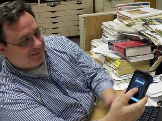 Sean Adkins demonstrates his tazer app.