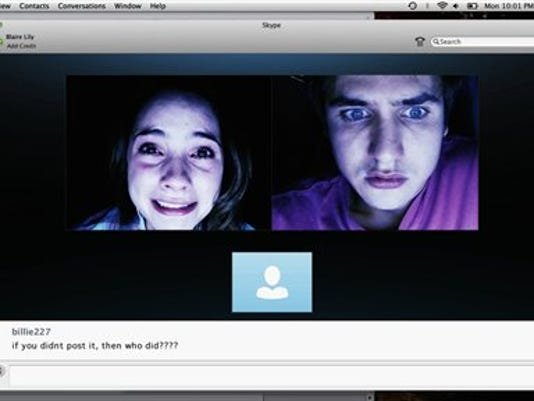 """In this image released by Universal Pictures, Shelley Henning, left, and Moses Storm appear in a scene from """"Unfriended."""" (Universal Pictures via AP)"""