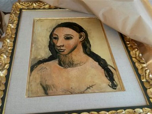 This photo taken on Friday, July 31, 2015 and made available on Tuesday, Aug. 11, 2015 by French Customs shows a 24 million-euro ($27.4 million) masterpiece by Pablo Picasso, seized from a boat cargo on July 31 from a boat cargo in Corsica, France.