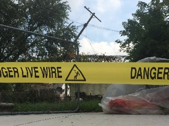 A downed power line is seen on September 9, 2014.