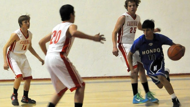 Hondo's Edwin Prudencio races to the basket as Corona's Sam Brown, Jaime Morales and Travis Lucero move to the ball at the last game of regular season play in Corona.