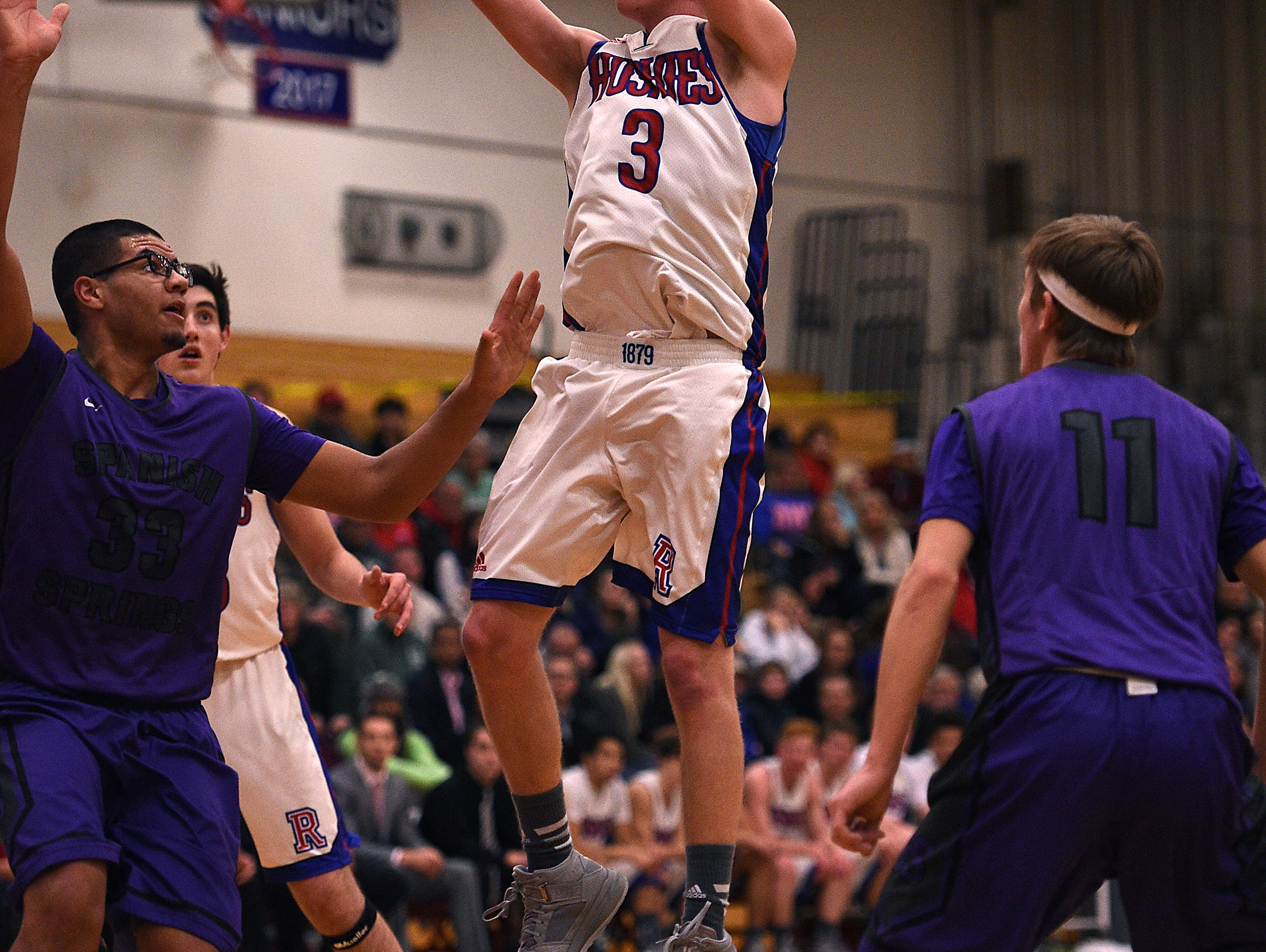 Reno's Drew Rippingham (3) shoots while taking on Spanish Springs during their basketball game last season.