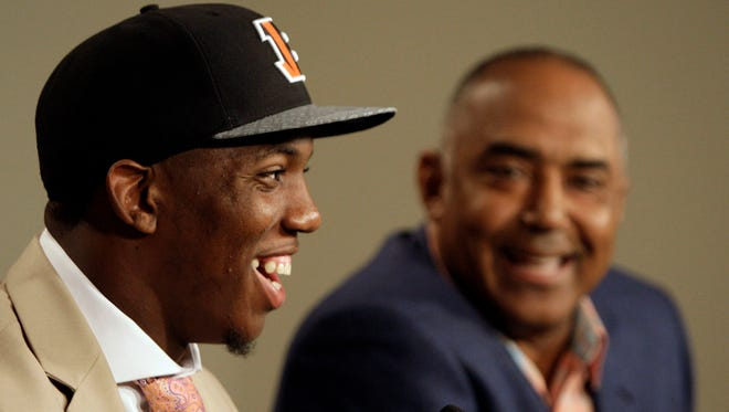 Cincinnati Bengals first round draft pick cornerback Darqueze Dennard from Michigan State, laughs as he and Marvin Lewis, right face the media during his introductory press conference at Paul Brown Stadium.