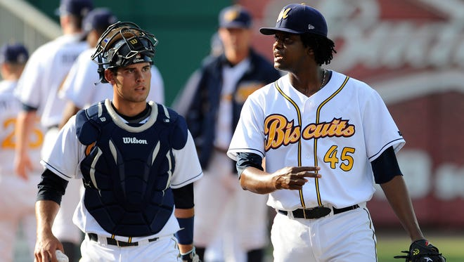 Montgomery Biscuit catcher Luke Maile and pitcher Victor Mateo talk before the Biscuits play the Pensacola Blue Wahoos at Riverwalk Stadium in Montgomery, Ala. on Saturday June 7, 2014.