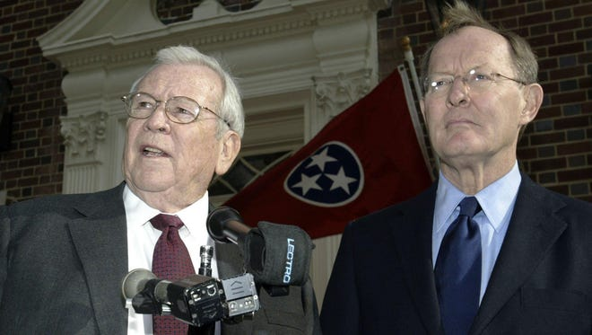 U.S. Ambassador to Japan Howard Baker, left, and Tennessee Sen.-elect Lamar Alexander speak Dec. 20, 2002, in Knoxville about Sen. Trent Lott's decision to resign as Republican majority leader. Both support Tennessee Sen. Bill Frist to fill the position.
