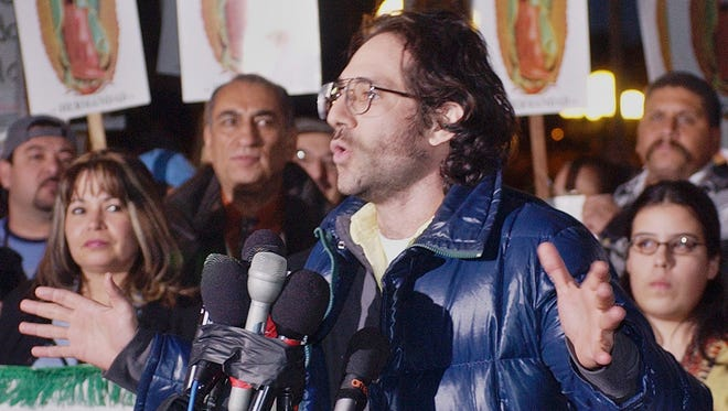 Dov Charney announces he will shutter his garment manufacturing plant that employs some 1,500 workers, in observance of a scheduled Dec. 12 economic strike by Latinos, at a rally on Dec. 11, 2003, in Los Angeles. The board of American Apparel has voted to oust Charney as chairman.