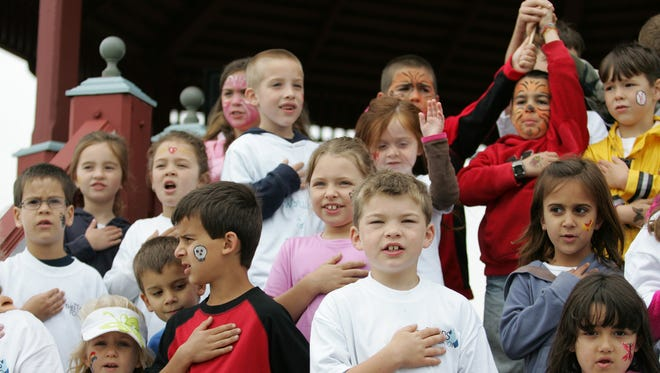 "A family is suing the Matawan-Aberdeen Regional School District in New Jersey, contending that the phrase ""under God"" in the Pledge of Allegiance is discriminatory toward atheist children. Children recite the Pledge of Allegiance in this 2010 file photo in Bradley Beach, N.J."