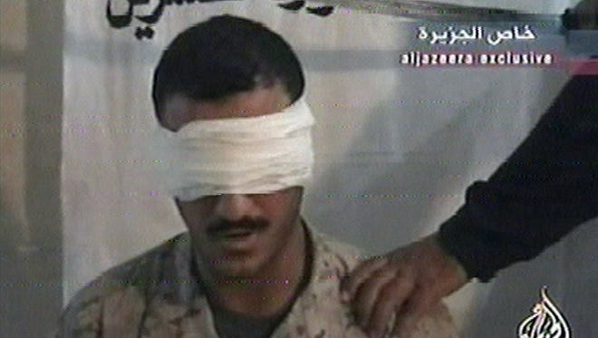 This June 27, 2004, image from a video broadcast by the Al-Jazeera network shows a man identified as Marine Cpl. Wassef Hassoun.