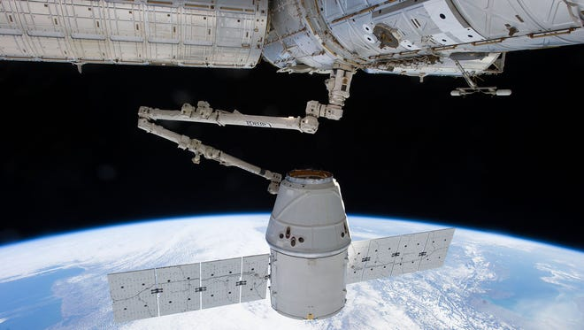 Photo taken by an Expedition 34 crew member aboard the International Space Station during the March 3, 2013, approach, capture and docking of the SpaceX Dragon cargo capsule. NASA will soon decide which company will fly crew to the space station.