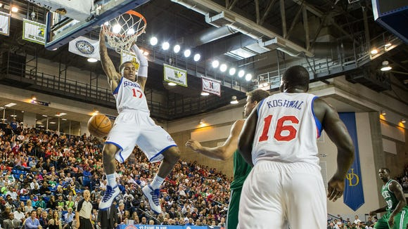 Vander Blue (left) finishes off an alley-oop during a preseason game in October.