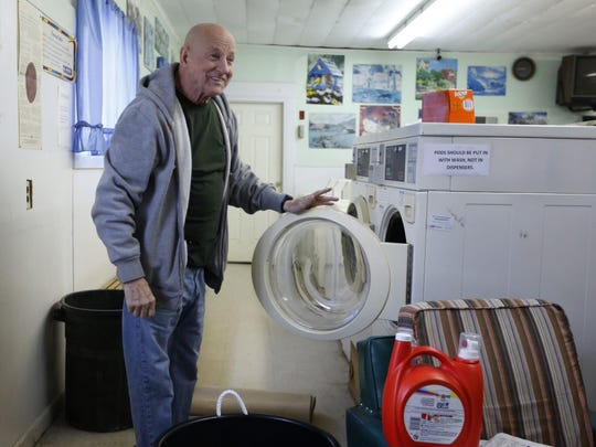 Larry Towle does his wash Thursday in Corinth, Maine. Towle, who voted for Hillary Clinton, said he was discouraged by her loss, but acknowledged her baggage may have proved too much for conservative-leaning voters.