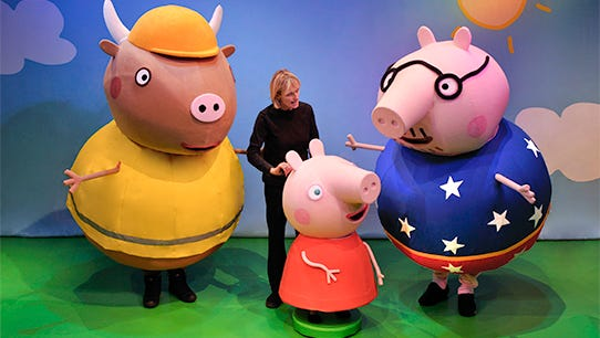 The titular puppet in Peppa Pig's Big Splash, with help from Alison Grant (Limelight Group), turns to Daddy Pig as Mr. Bull looks on.