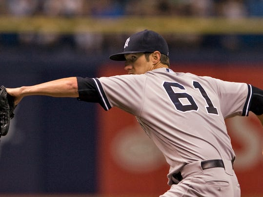 New York Yankees starter Shane Greene pitches against the Tampa Bay Rays during the first inning of a baseball game Saturday, Aug. 16, 2014, in St. Petersburg, Fla. (AP Photo/Steve Nesius)