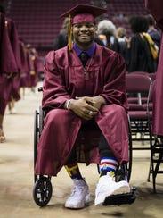 Cam Brown prepares for Florida High's graduation at