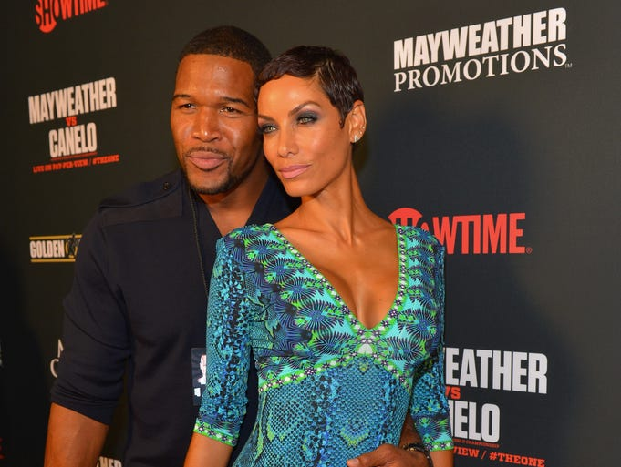 A big fight always draws big stars. USA TODAY's Ann Oldenburg takes a look at who turned out to see the Showtime PPV Floyd Mayweather Jr. vs. Canela Alvarez boxing match at the MGM Grand Garden Arena in Las Vegas on Saturday night. First up: former NFL player and  talk show host Michael Strahan and Nicole Murphy.
