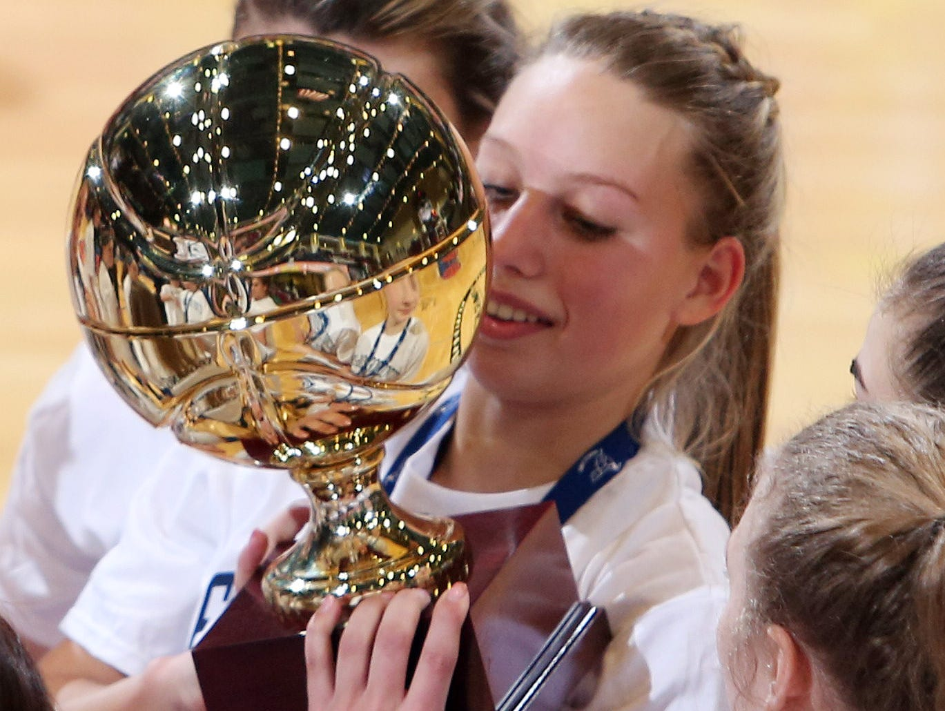 Haldane's Alzy Cinquanta celebrates with her teammates and the gold ball after defeating Hamilton 47-39 in the girls basketball Class C championship game at the Westchester County Center in White Plains March 4, 2017.