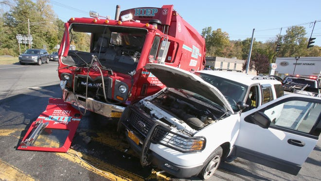 A garbage truck and an SUV were part of a multi-vehicle accident on Route 303 and Snake Hill Road in West Nyack on Oct. 9, 2014.