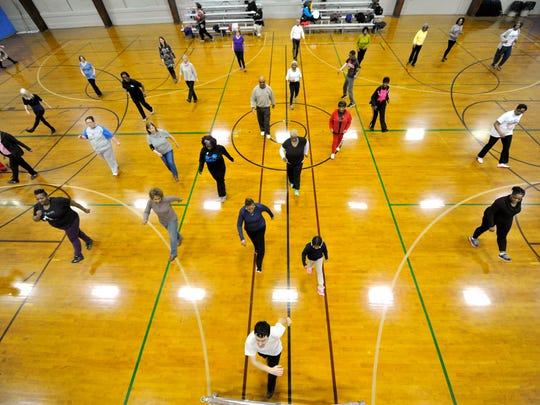Instructor Dante Strange, front, leads a class of more than thirty people  in the first Healthy Movin' Mondays line dance at Voni Grimes Gym on Monday, Feb. 8, 2016. The event is part of Mayor Kim Bracey's new healthy initiative on the second Monday of every month. In addition to the line dancing, visitors were presented with information from the York City Bureau of Health.