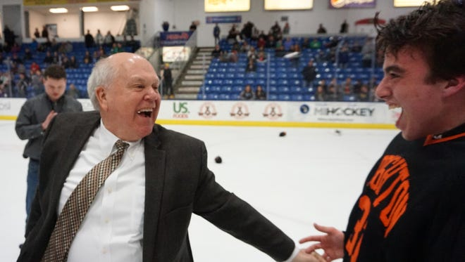 Brighton coach Paul Moggach celebrates with goaltender Robert Pegrum after leading the Bulldogs to their fifth state hockey championship on March 10, 2018 at USA Hockey Arena in Plymouth.